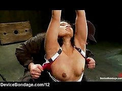 Bound on her knees babe gets flogged