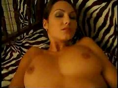 Young woman undressing and stroking