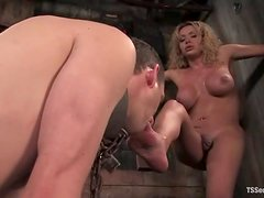 Kinky blonde tranny chains a guy and fucks him in the ass