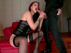 Redhead wears leather and stockings as she sucks