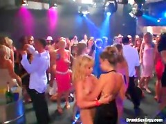 Chicks on stage at a wild club suck and fuck