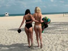 Two mesmerizing chics swim in ocean wearing outright bikini
