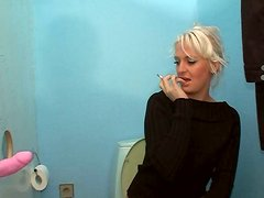 Blonde slut Lili sucks the dick through the gloryhole