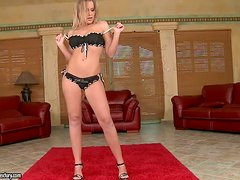 A beautiful blonde babe strips & masturbates