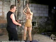 Girl in tight latex suffers through tit torture