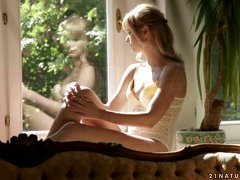 Slender Charlise Bella has sensual sex on a sofa