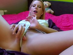 Blonde nymph toys her pussy with double headed dildo