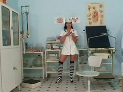 Horny and tanned nurse Lucie V examines shy dude's dick and desires to please it