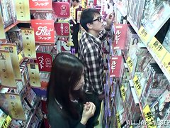 Slutty Japanese girl sucks dicks and gets nailed in a shop