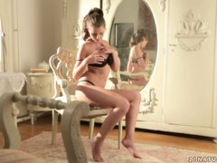 Sexy Liona Levi masturbates in front of the mirror