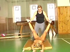 Tasty looking blond gymnast Michaela spreads her legs wide welcoming tongue fuck