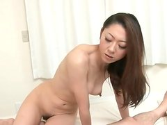 Asian girl slowly sits pussy on his cock