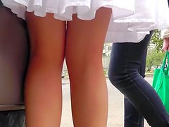 Beauty in cute dress is getting an upskirt