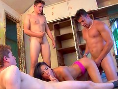 Brunette beauty fucking in gang bang