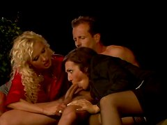 Appealing chicks are showing off their blowjob skills in threesome