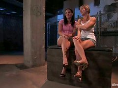 Two slim and hot babes get dominated in a dark basement