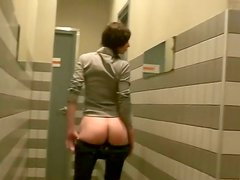 Slutty brunette amateur gives mouth fuck to two sturdy cocks in public toilet