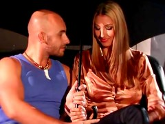 Blonde beauty in a satin blouse sucks his dick