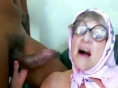 Old granny gets a black cock stoking