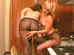 Slim brunette and blondie undress to tickle and tease each other's cunts