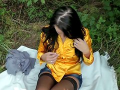 Lascivious brunette babe gets horny and masturbates in forrest