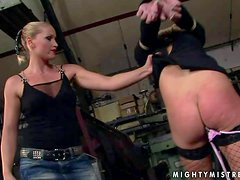 Arousing young blonde babe Kathia Nobili with heavy make up