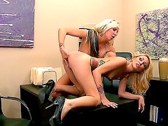 Blonde lesbians in age Eden Adams and Monique Alexander are having fun in an office.