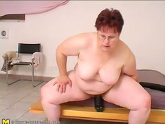 Fat chick sits on huge black didlo