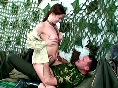 Playful military chic kneels down in front of horny dude that cumshot on her face