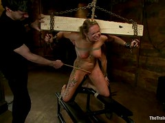 Two dudes are torturing this amazing blond sex slave