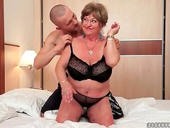 Fat old slut takes toy from young horny guy