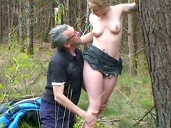 Slutty blonde Mitchell blows two cocks in the woods