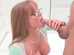 Spoiled blond milf with big baggy tits gives head to massive penis