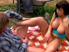 Brunette in glasses Michella gives he r boyfriend titsjob and  blowjob