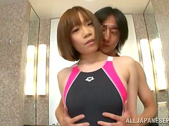 Sexy honey in swimsuit gives a Japanese blowjob