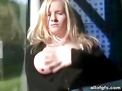 Blonde chick shows huge breasts in train