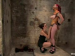 Redhead girl with big boobs gets tortured and wired