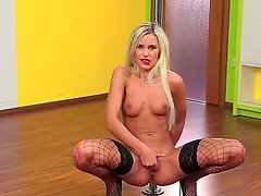Leggy blonde babe Dido Angel stays in black fishnet stockings and black high heeled shoes.
