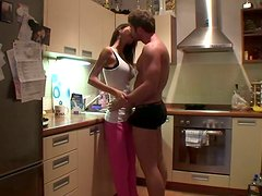 Torrid amateur brunette desires to suck her boyfriend's dick in the kitchen