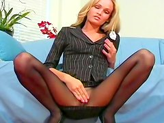 Blonde exposes her sexy pantyhose