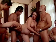 Pregnant slut gets fucked by a few horny dudes indoors