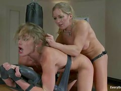 Blonde milf destoys some cute chick's ass with a strap on