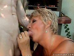 A kinky old couple use the BBQ to fuck outdoors