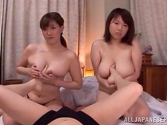 Two kinky Japanese chicks suck a cock in POV video