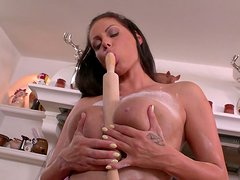 Bosomy brunette sexbomb bakes cake but ends up with masturbation solo