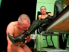 Dominant leather mistress gives him a strapon fuck