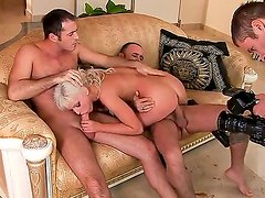Lusty blonde slut Alexandra Cat with dark heavy make up and natural boobs gives head