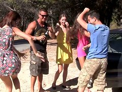 Group of horny amateur chicks drink some alcohol on way to beach