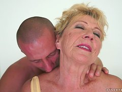 Old blonde woman gets her hairy pussy fingered and fucked