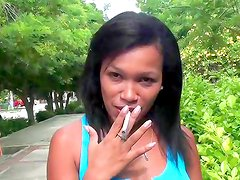 Busty brunette smokes and teases